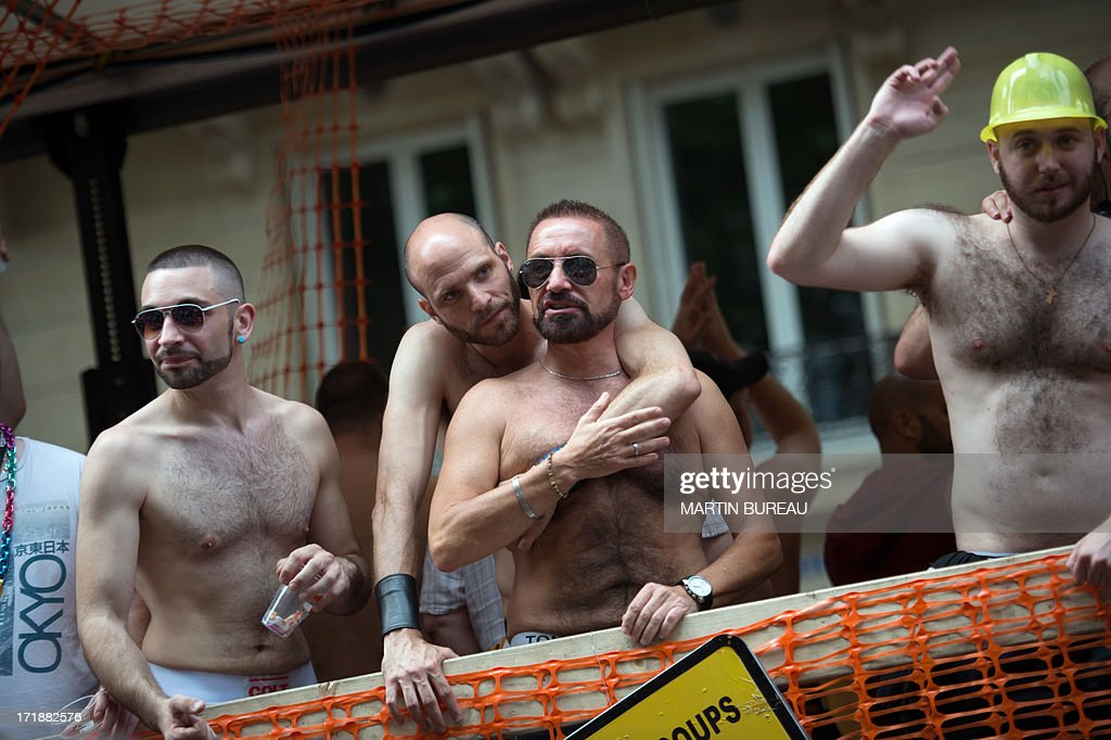 Men parade during the homosexual, lesbian, bisexual and transgender (HLBT) visibility march, the Gay Pride, on June 29, 2013 in Paris, exactly one month to the day since France celebrated its first gay marriage.