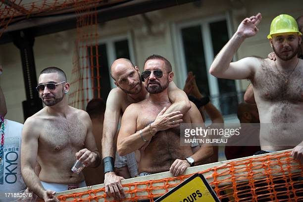 Men parade during the homosexual lesbian bisexual and transgender visibility march the Gay Pride on June 29 2013 in Paris exactly one month to the...