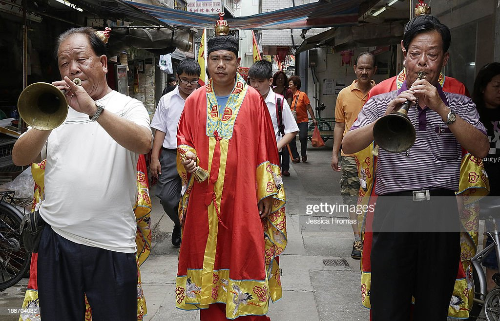 Men parade through the streets of Cheung Chau Island as part of a ceremony inviting Tin Hau's deity to the Pak Tai Temple at the Cheung Chau Bun Festival on May 14, 2013 in Hong Kong, Hong Kong. Today is the start of the Cheung Chau Bun Festival which will run until 17 May and celebrates the eight day of the fourth moon in the Chinese calendar.