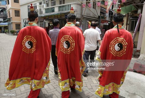 Men parade through the streets of Cheung Chau Island as part of a ceremony inviting Tin Hau's deity to the Pak Tai Temple at the Cheung Chau Bun...