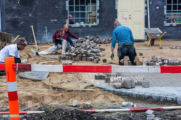 Men paving ground in Freetown Christiania