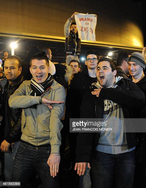 Men perform a 'quenelle' salute after the cancellation of the performance of French controversial humorist Dieudonne M'bala M'bala on January 9 2014...