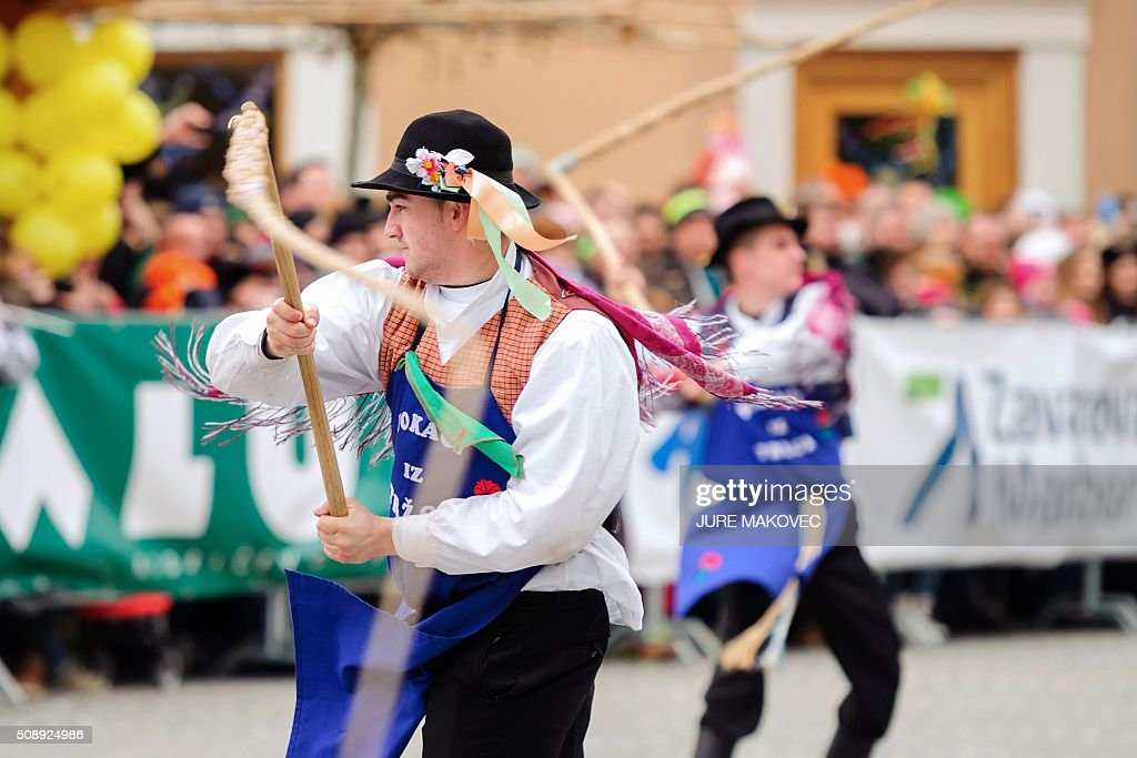 Men perform with wipes during the Ptuj carnival parade in Ptuj, on February 7, 2016. The Ptuj carnival is the largest in Slovenia and last 11 days. / AFP / JURE MAKOVEC