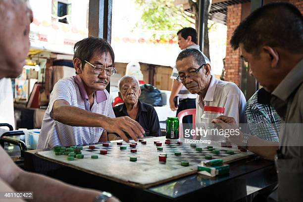 Men play and observe a game in a recreational space in the area of Chinatown in Singapore on Monday Jan 6 2015 In a culture that traditionally...