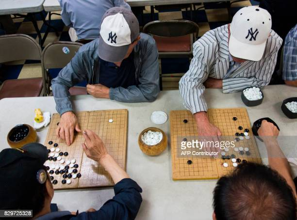 Men play Baduk the Korean version of Go at the Korean Community Services center on August 10 in New York Most of those at the center said they hope...