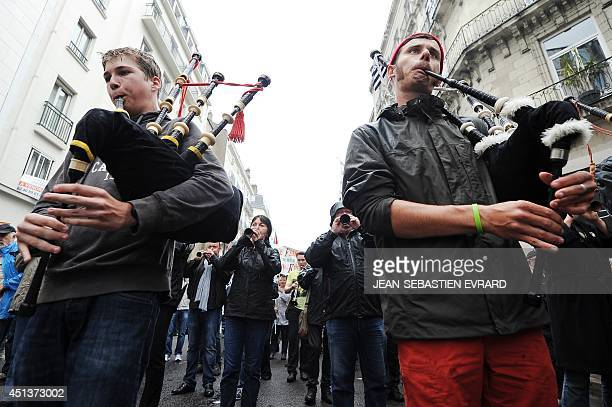 Men play bagpipes during a demonstration for the reunification of the LoireAtlantique department to the region of Brittany on June 28 2014 in Nantes...