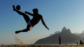 Men play football on Ipanema Beach ahead of the Preliminary Draw of the 2014 FIFA World Cup on July 28 2011 in Rio de Janeiro Brazil