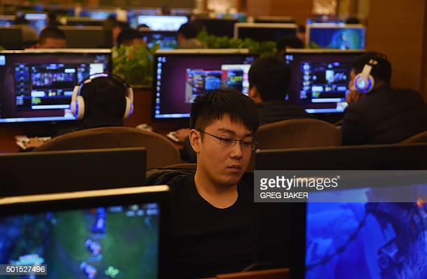 Men play games on computers in an internet bar in Beijing on December 16 2015 'Freedom and order' are both necessary in cyberspace Chinese President...