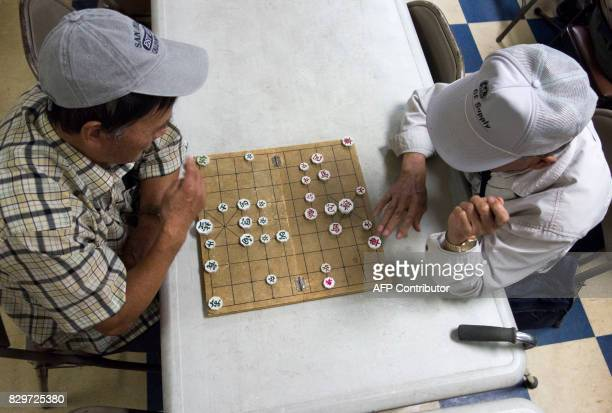 Men play Janggi the native chess of Korea at the Korean Community Services center on August 10 in New York Most of those at the center said they hope...