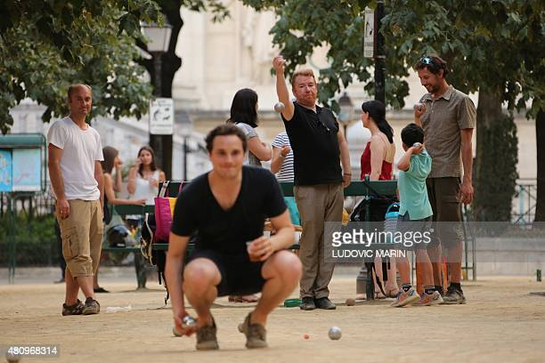 Men play petanque at the place Dauphine in Paris on July 16 2015 AFP PHOTO / LUDOVIC MARIN