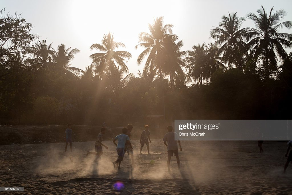 Men play soccer in Dala Township on February 11, 2013 in Yangon, Burma. Myanmar is going through rapid political and economic reforms initiated by the countries first civilian president Thein Sein after years of military junta rule.