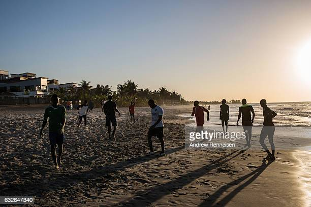 Men play soccer on the beach on January 24 2017 in Serekunda The Gambia Many popular travel destinations still remain empty after an exodus of...