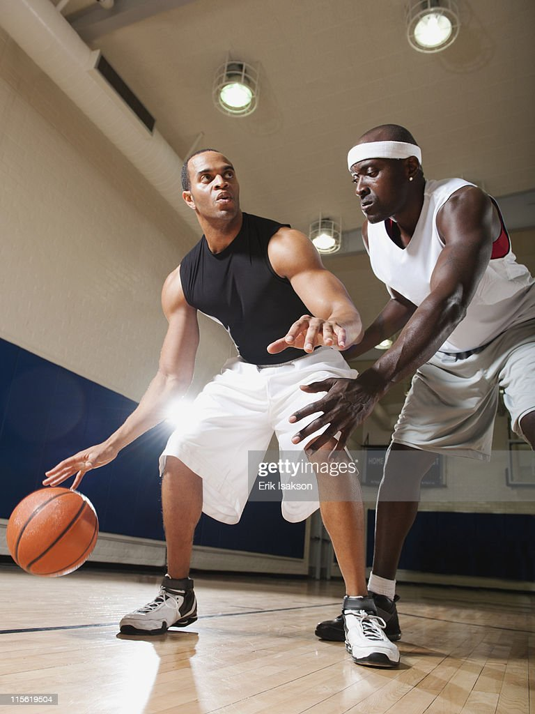 Men playing basketball on basketball court : Stock Photo