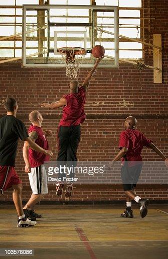Men playing basketball : Stock Photo