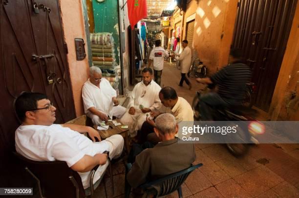Men playing cards at Medina Souk, Marrakech, Morocco
