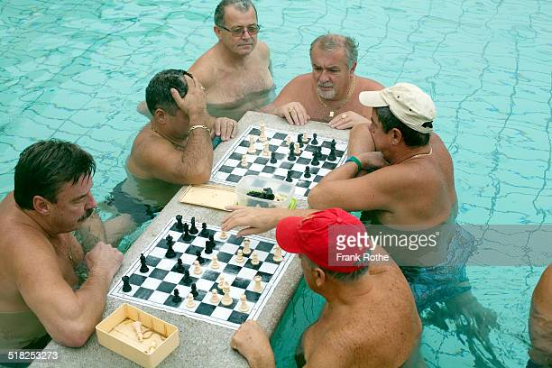 men playing chess in a thermal bath