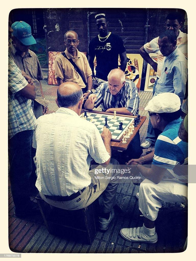 CONTENT] Men playing chess in El Conde pedestrian street in Santo Domingo colonial zone.