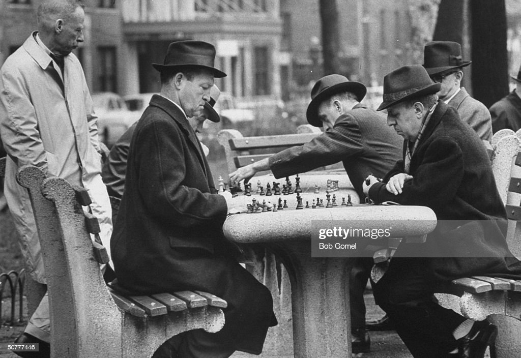 Men playing chess on an early spring day.