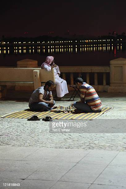 Men playing chess on the seafront in Jeddah, Saudi Arabia