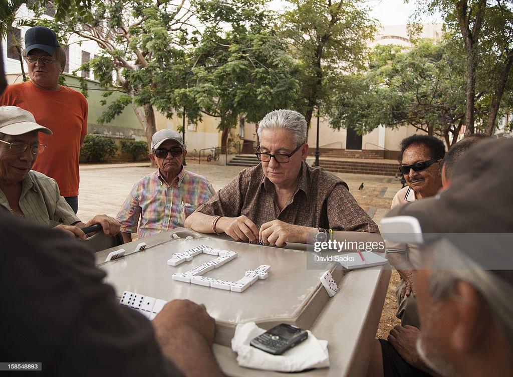 Men playing dominos : Stock Photo