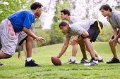 Men playing flag football