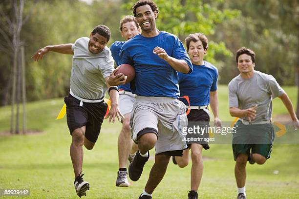 Men playing flag football together