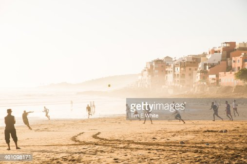 Men playing football on the beach, Taghazout, Moro