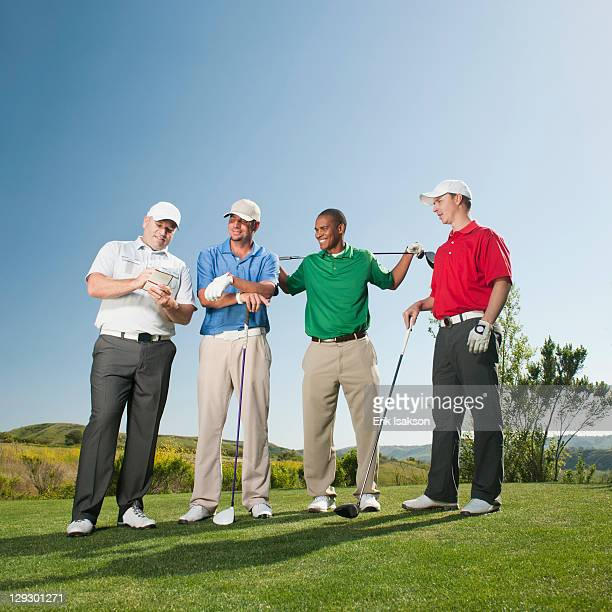 Men playing golf together on golf course