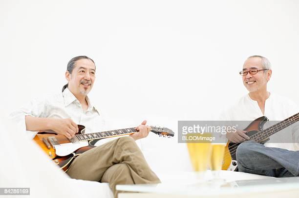 Men playing guitar and bass guitar