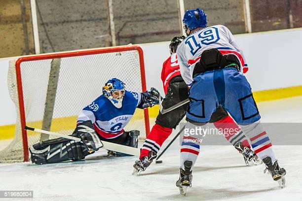 Men playing ice hockey
