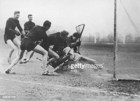 Men playing lacrosse (B&W) : Stock Photo