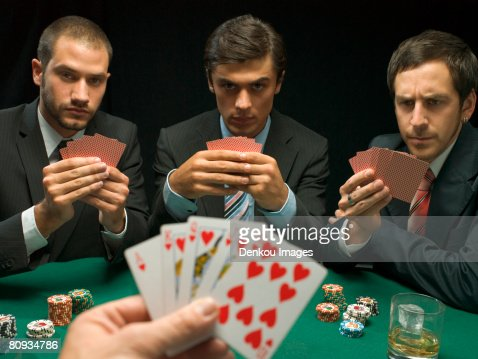 Guys playing poker