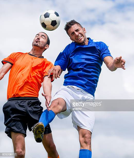 Men playing soccer