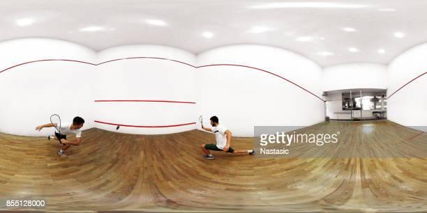 Men playing squash game