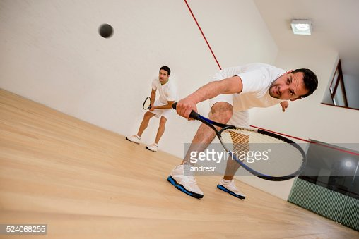 Men playing squash