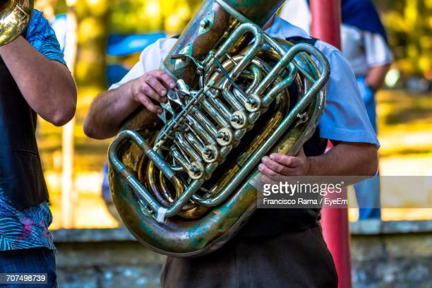 Men Playing Tuba At Event