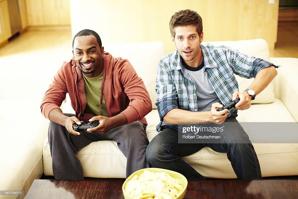 Men playing video games.