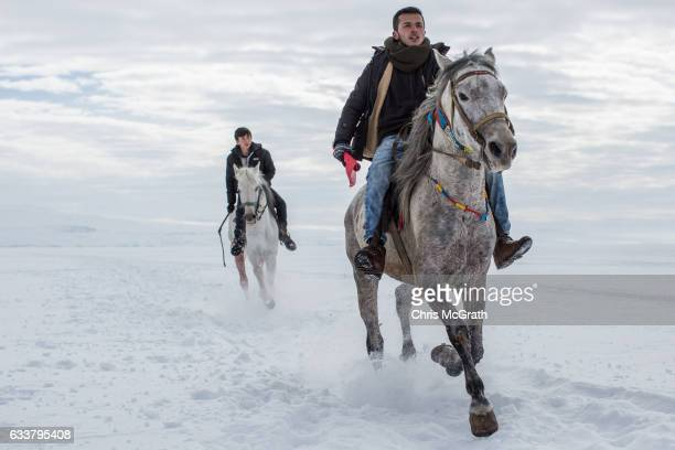 Men practice prior to the start of a horse race across the frozen Cildir Lake during the Cildir Lake Golden Horse Festival on February 4 2017 in...
