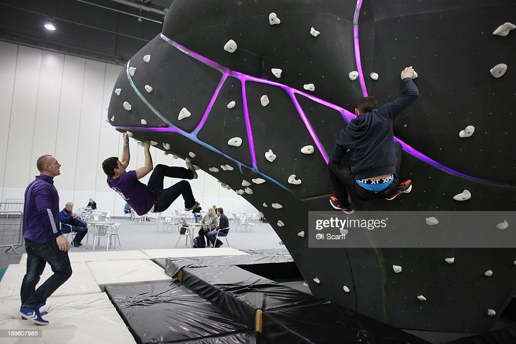 Men practice their bouldering at The Outdoors Show which is being held in the ExCeL Centre on January 17, 2013 in London, England. The ExCeL centre is hosting The Outdoors Show, the London Bike Show and the Active Travel Show which run until January 20, 2013 and features manufacturer trade stalls, speeches, demonstrations and areas where visitors can climb or ride bikes.
