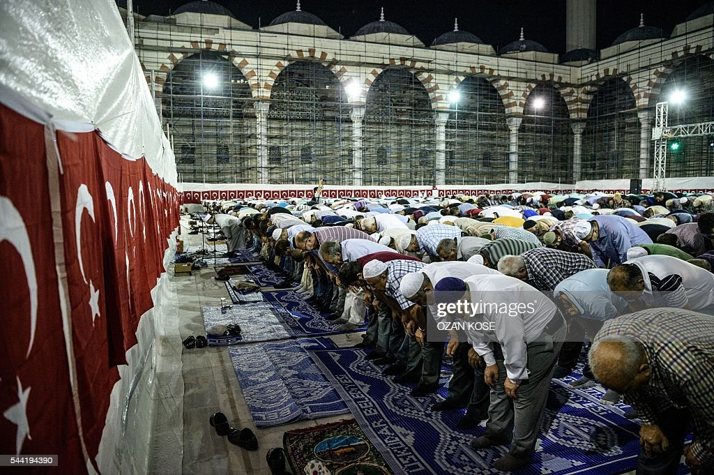 Men pray at the new Camlica mosque in Istanbul on July 1, 2016. Istanbul's towering Camlica mosque received its first worshippers, as Turkey unveils the latest grand project emblematic of President Recep Tayyip Erdogan's big ambitions. Erdogan personally supervised the controversial construction of Turkey's biggest mosque -- designed to accommodate up to 60,000 worshippers and visible to all from its perch on a hill on Istanbul's Asian side. / AFP / OZAN