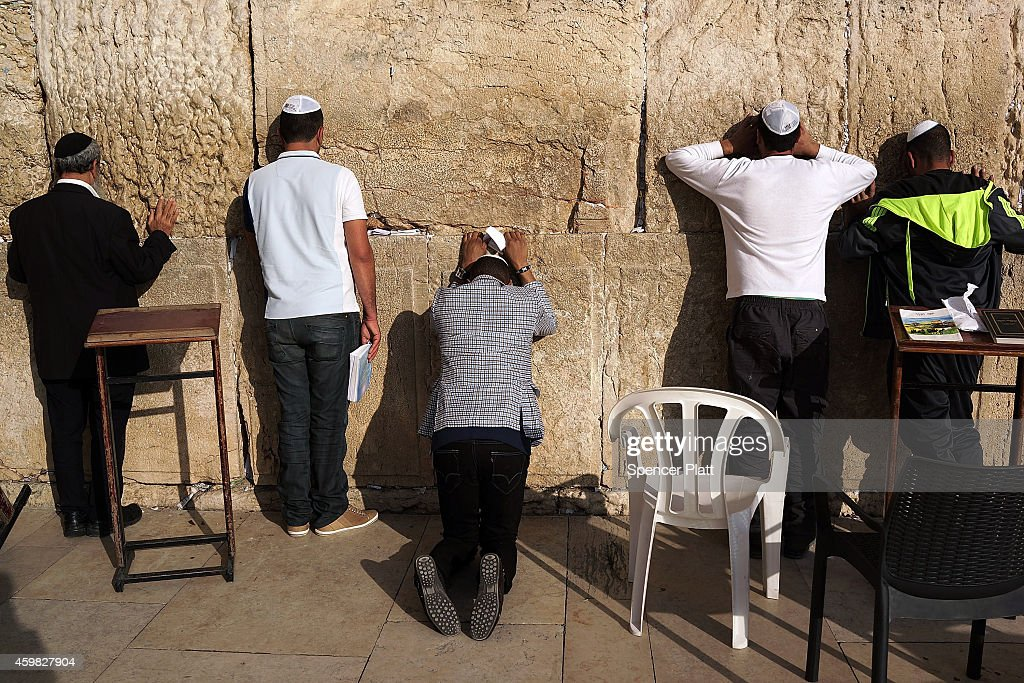 Men pray at the Western Wall in the Old City on December 02 2014 in Jerusalem Israel As violence continues in Israel an Israeli was stabbed and...