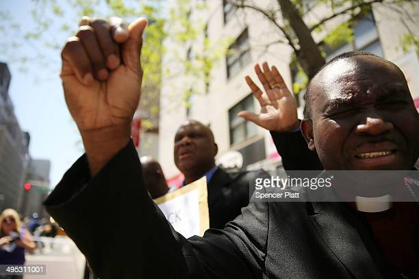 Men pray for the safe return of the 276 abducted schoolgirls outside the Permanent Mission of Nigerian to the United Nations on June 2 2014 in New...