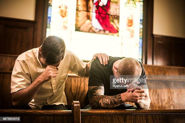 Men Pray Together in Church