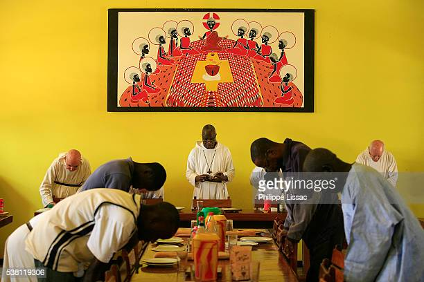 Men Praying Before Meal at Keur Moussa Abbey