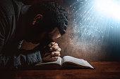 Men praying to God.