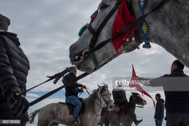 Men prepare to take part in a horse race across the frozen Cildir Lake during the Cildir Lake Golden Horse Festival on February 4 2017 in Cildir...