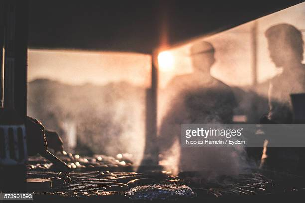 Men Preparing Food Outdoors