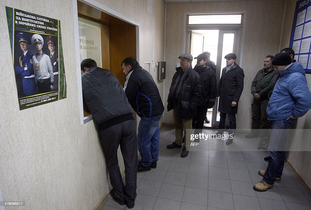 Men queue at the reception of a military enlistment office in Kiev, on March 2, 2014. Ukraine is to call up all military reservists, the head of the national security and defence council said Sunday, after Russia's parliament approved the deployment of troops in the country. Ukraine warned Sunday it was on the brink of disaster after Russia's threat to invade its neighbour drew sharp rebukes from the United States and NATO.