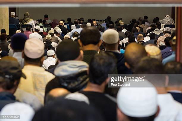 Men queue to enter the main prayer hall of the East London Mosque for the first Friday prayers of the Islamic holy month of Ramadan on June 19 2015...