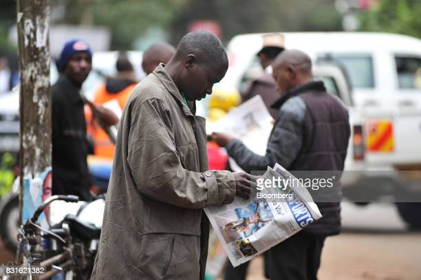 Men read daily newspapers on a roadside in Nairobi Kenya on Tuesday Aug 15 2017 Kenyan opposition leader Raila Odingas chances of overturning the...